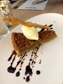 Pignoli tart with olive oil gelato